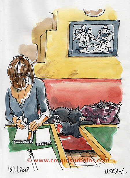 Fille dessinant au bar